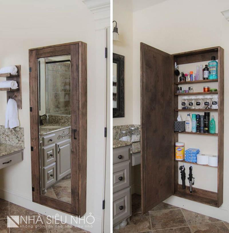 Tủ treo tường mỏng với cánh tủ ốp gương, có cảm giác không gian rộng và sáng hơn. Cất gọn tất cả các chai lọ đồ đạc vào cảnh tủ này thì nhà tắm cũng rộng ra vài phần