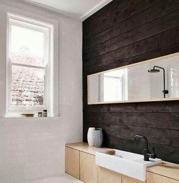 Một thiết kế rất tận dụng: Bồn rửa âm vào vủ và gương soi cũng kiêm chức năng của tủ đồ. Sử dụng 1 chút gam màu tối để làm nổi bật các gam màu sáng hơn